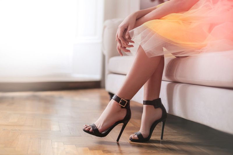 Elegant lady wearing a yellow skirt and black high heels