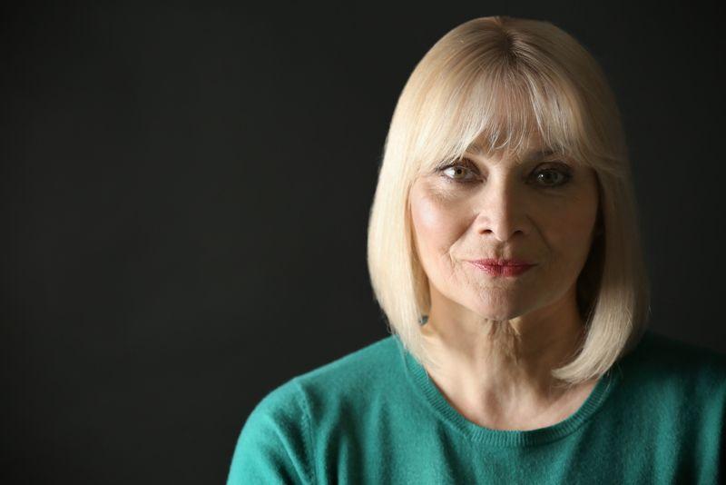 Portrait of senior woman on dark background