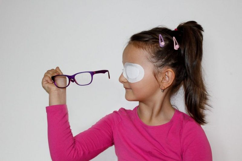 A child with eye patch.