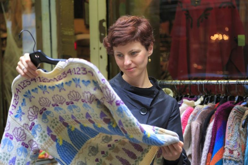 Woman shopping for vintage clothing