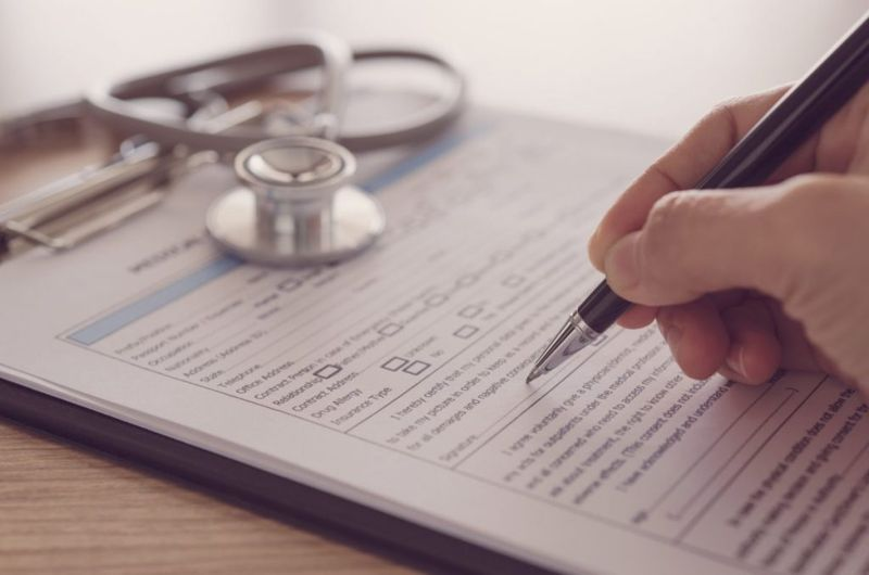 Completing a health history form