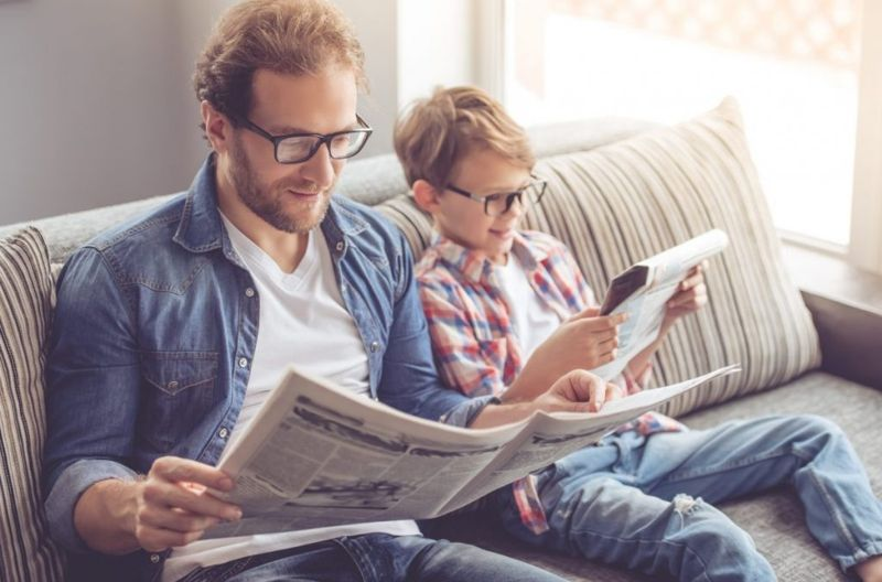 An image of a father and son reading
