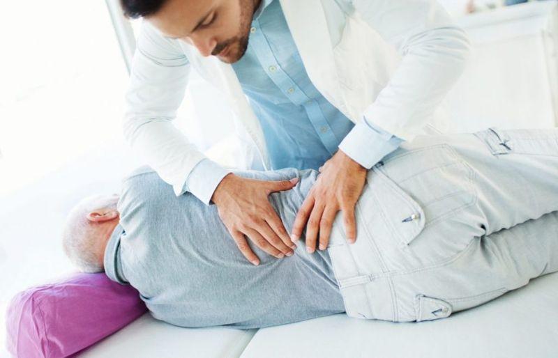 doctor examining lower back