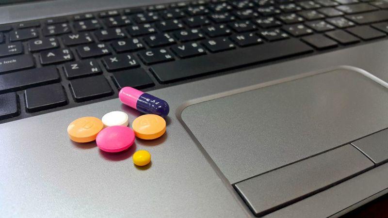 Tablets on a laptop keyboard