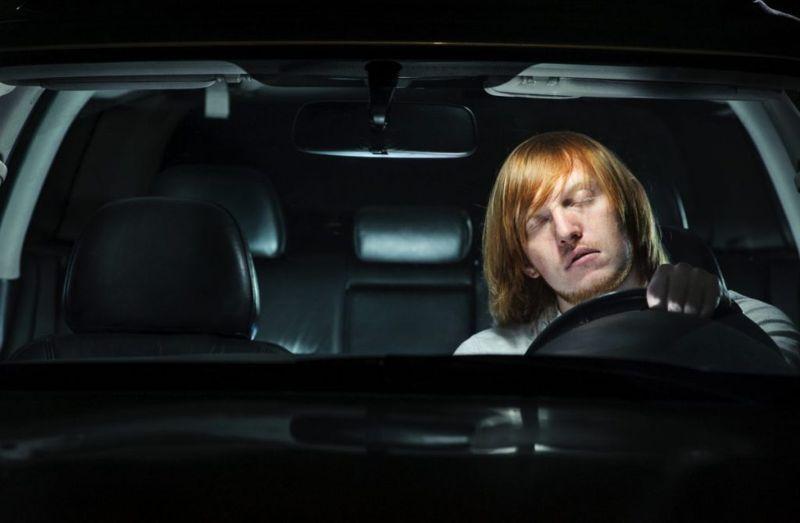 man falling asleep while driving