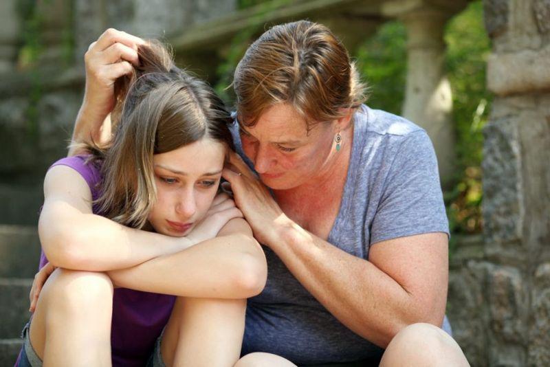mother daughter sad