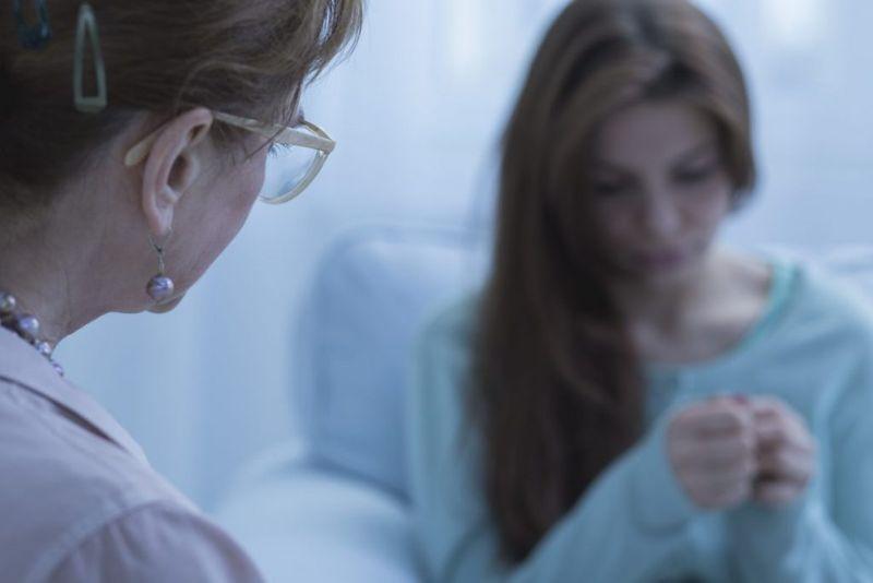 woman depression doctor visit