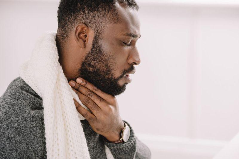 gargle sore throat man