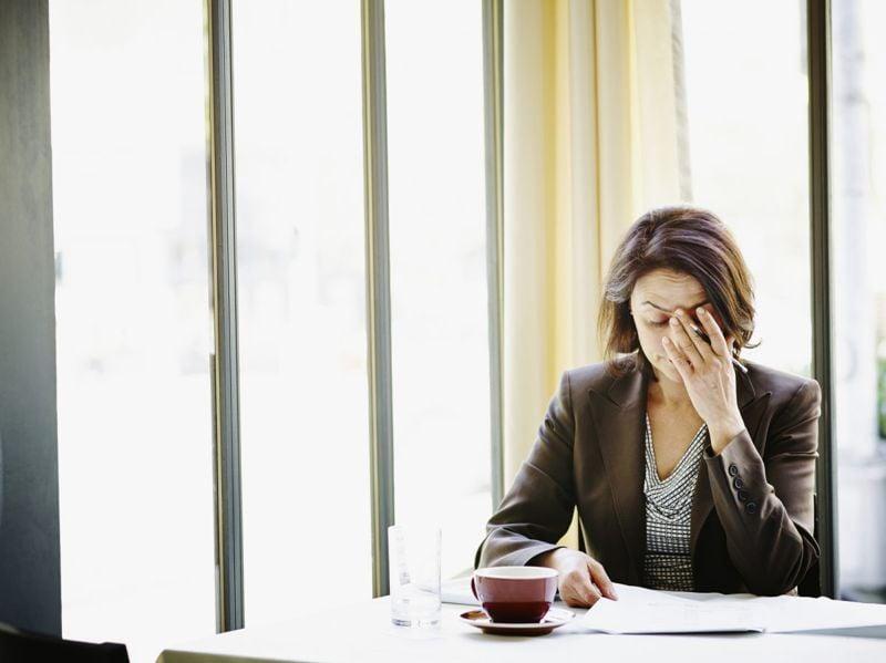 woman coffee headache