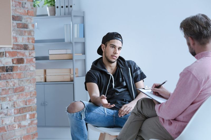 man in counseling session