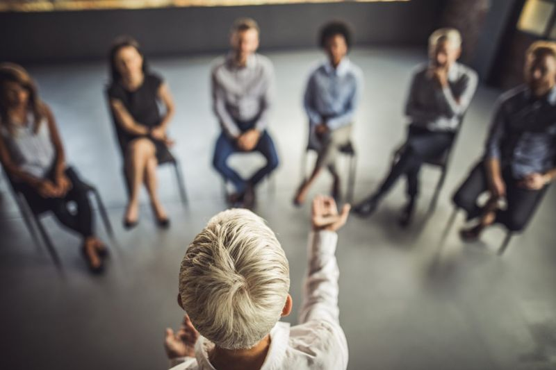 Woman leading group therapy