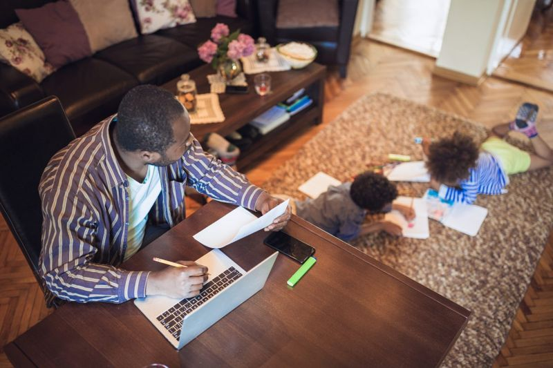 father children working home