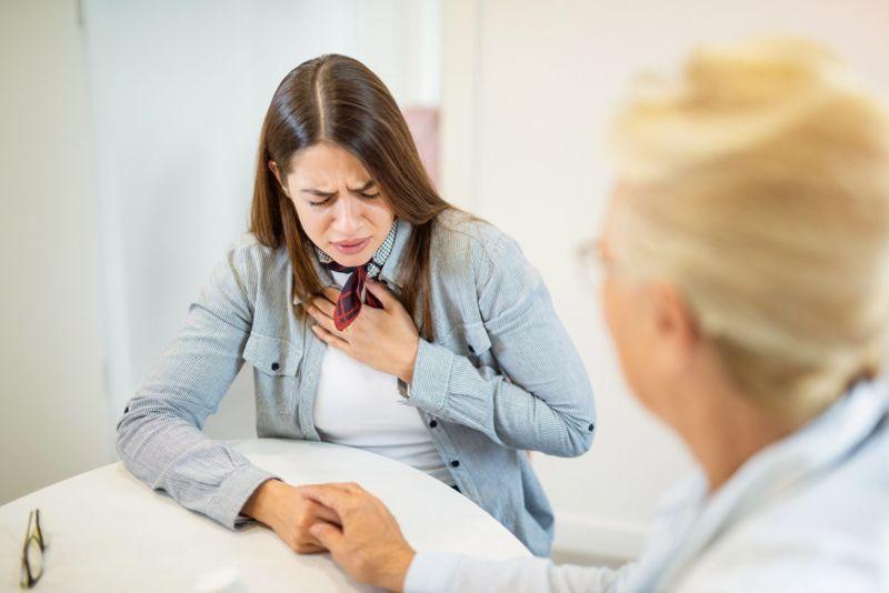 sneeze heart woman chest