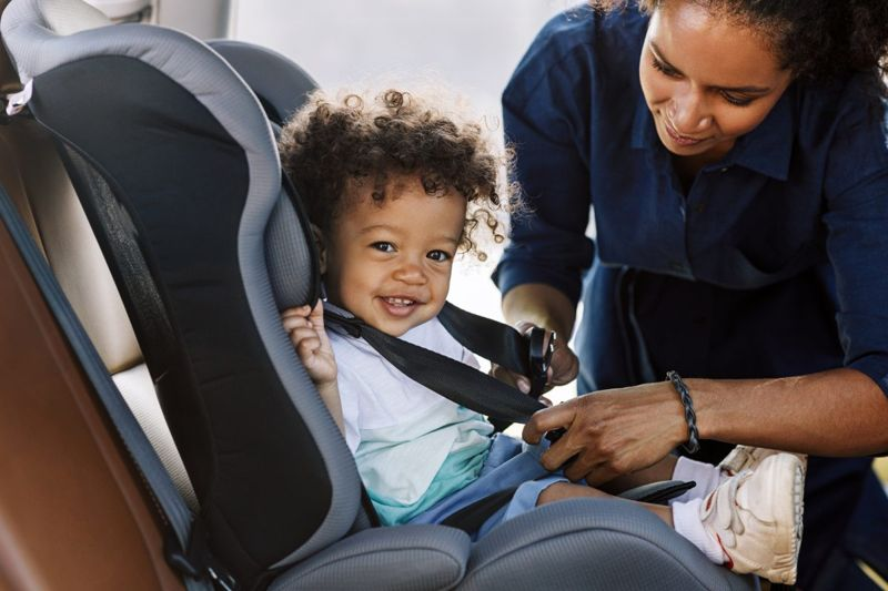 Baby smiling in backseat