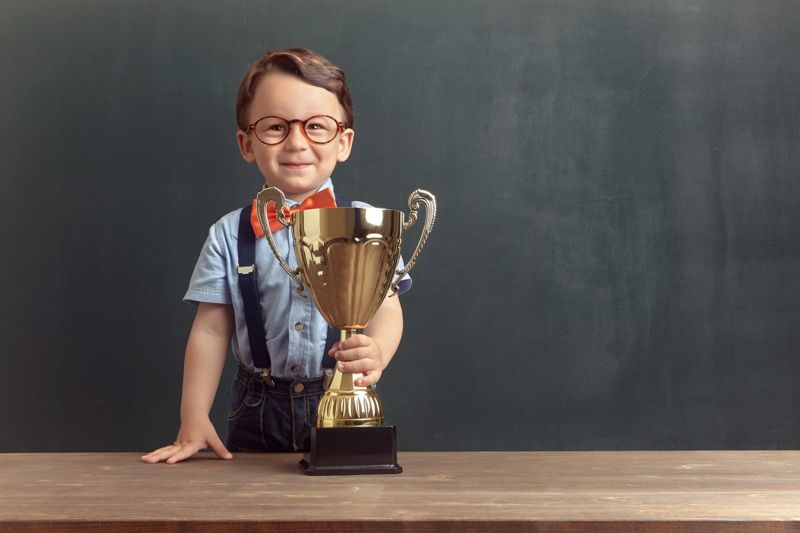Small boy holding trophy