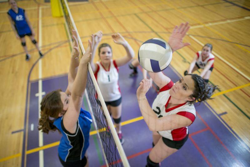 girls spiking volleyball