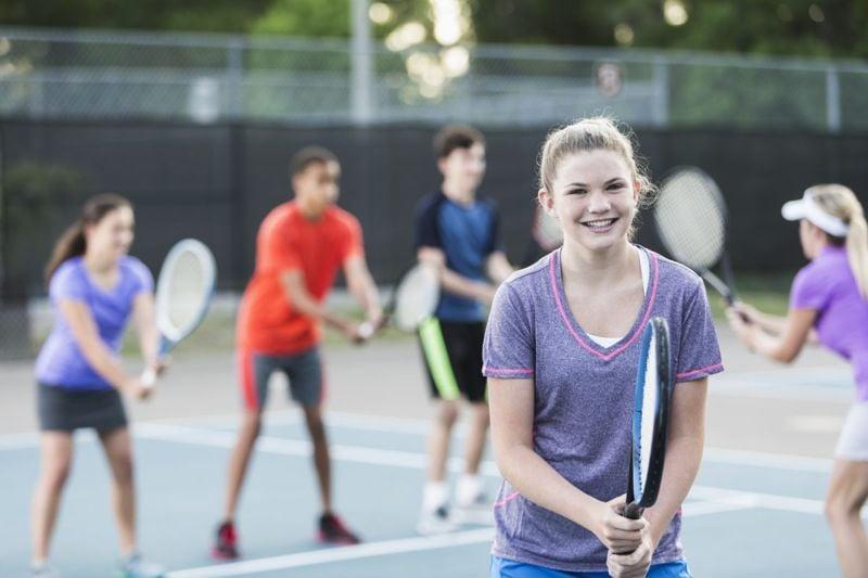 teens playing tennis