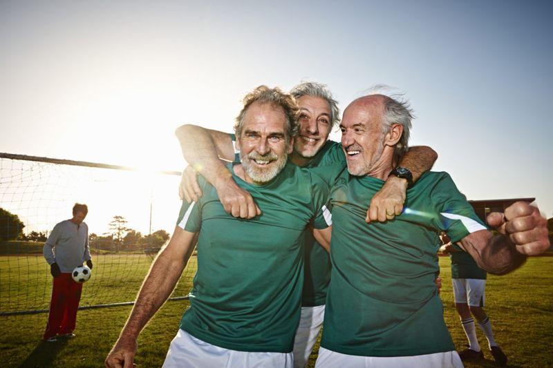 Soccer team hugging
