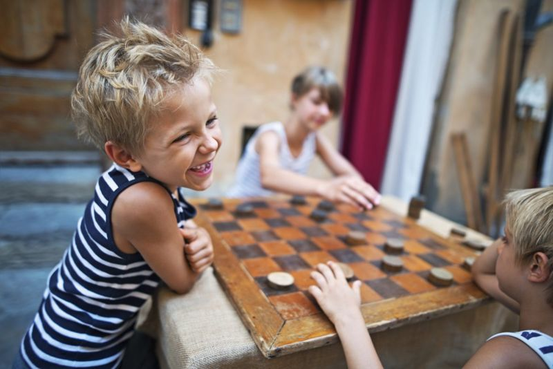 Checkers is a great game for kids and adults and equipment can be improvised if you don't have a set.