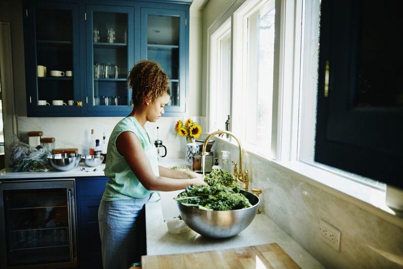 woman washing salad healthy