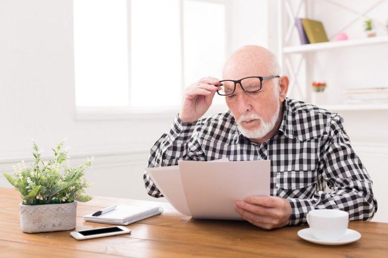 senior man reviewing papers