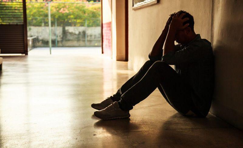 man sitting, stressed body language