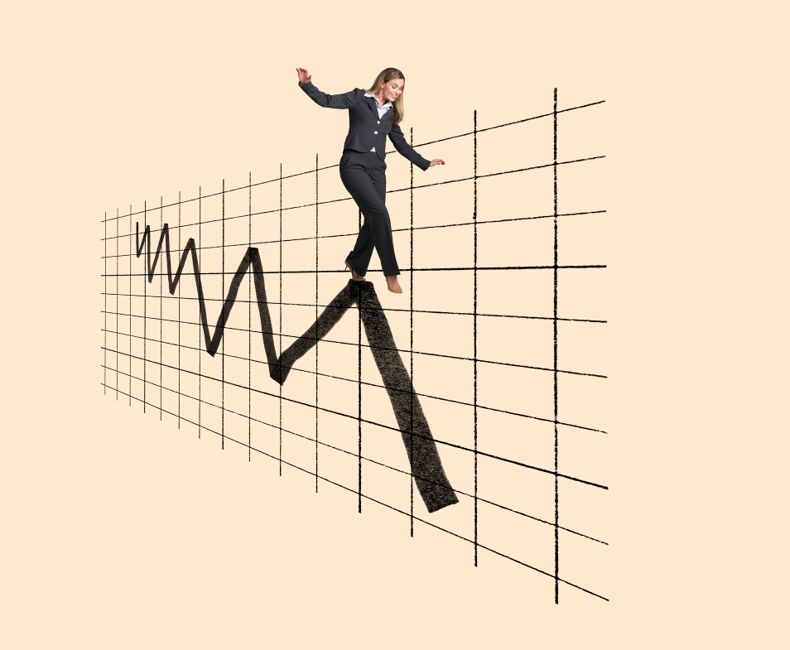 A businesswoman balances herself on top of a financial chart that shows the volatility and wild ride of the financial markets.