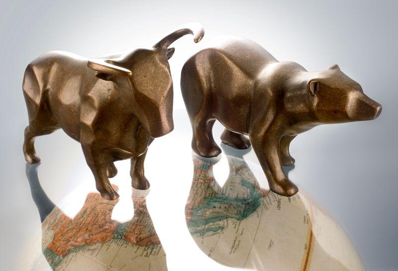 financial bull bear on globe