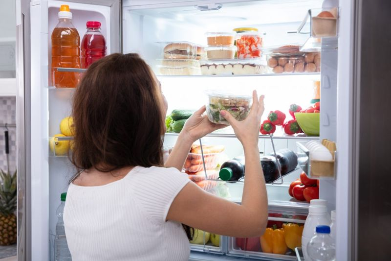 taking food from refrigerator