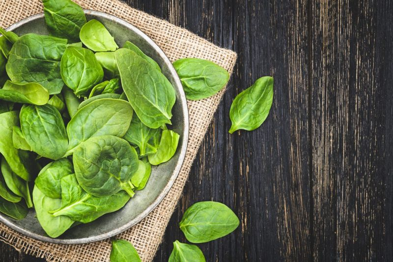 Salad greens should be submerged in cool water and gently agitated for cleaning.