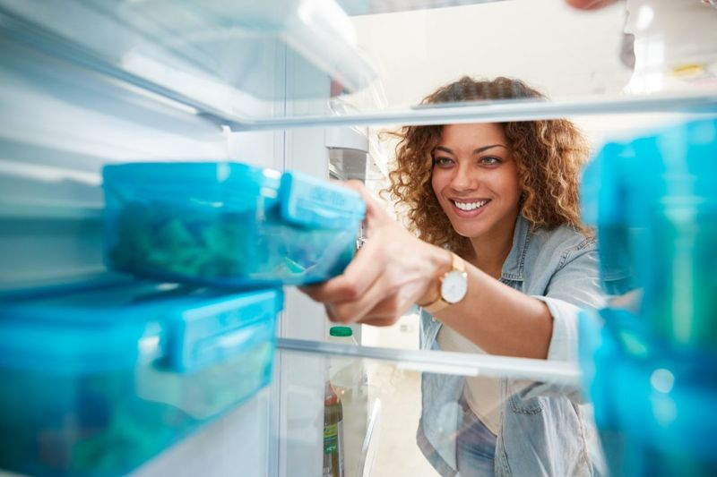 placing containers in refrigerator