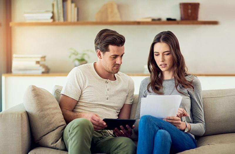 Couple reviewing application together