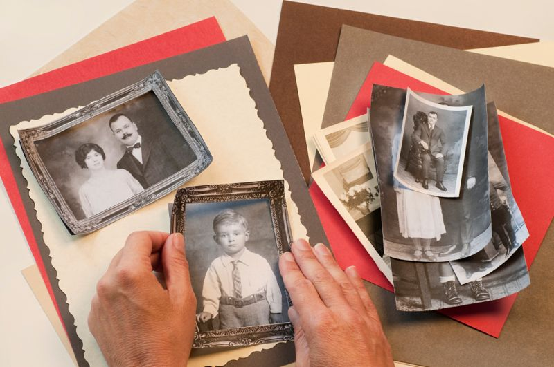 Creating a scrapbook layout of vintage family photos.
