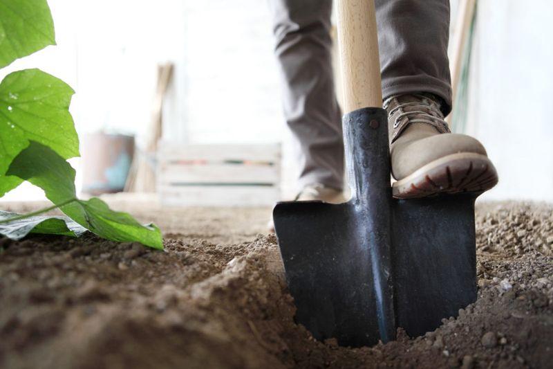 preparing soil shovel garden