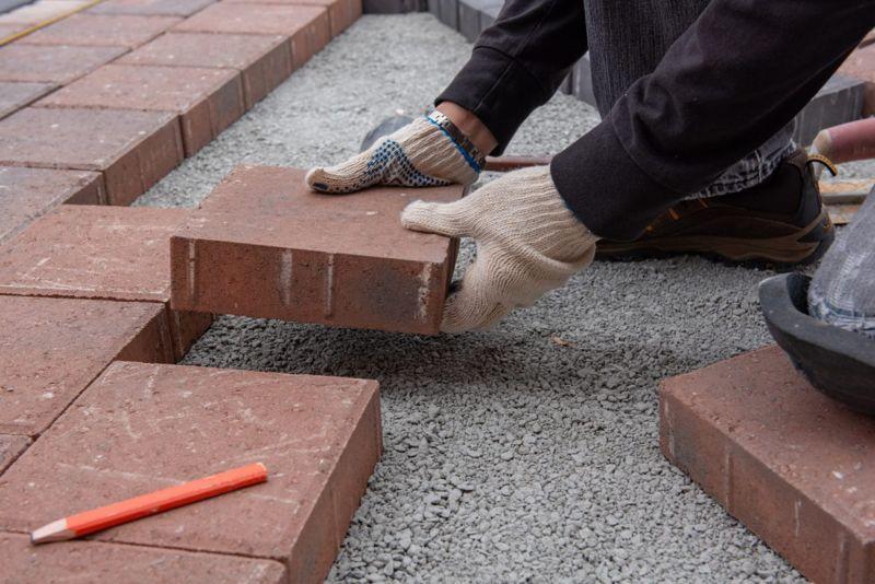 laying paver flooring brick