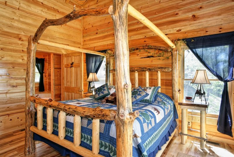 Wooden bed in wooden cottage