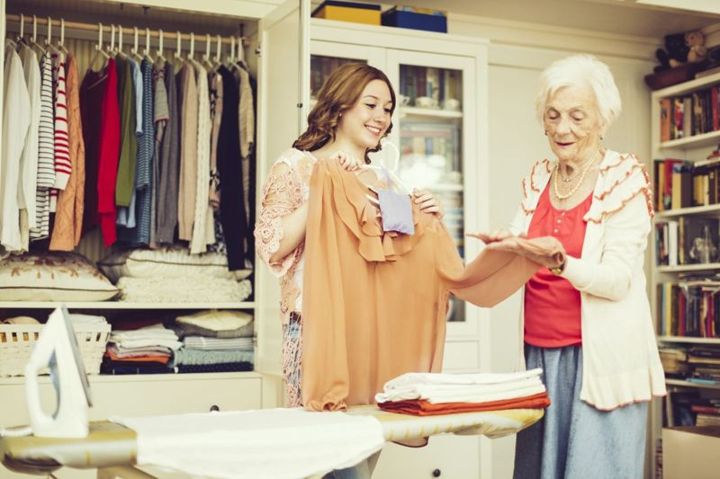 senior woman choosing clothes
