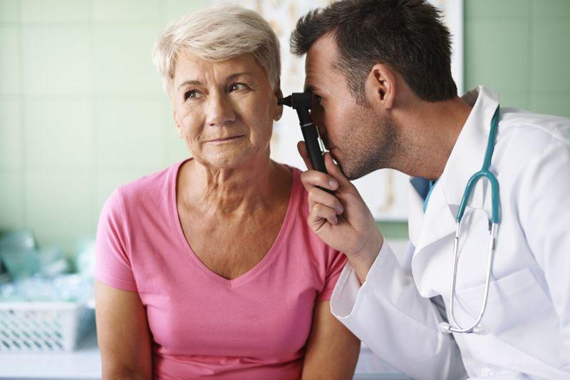doctor looking at ear