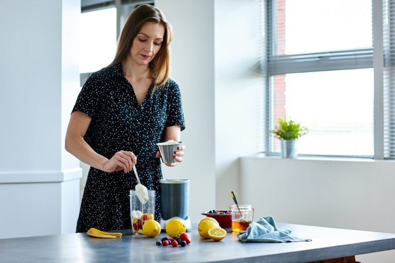 female making smoothie