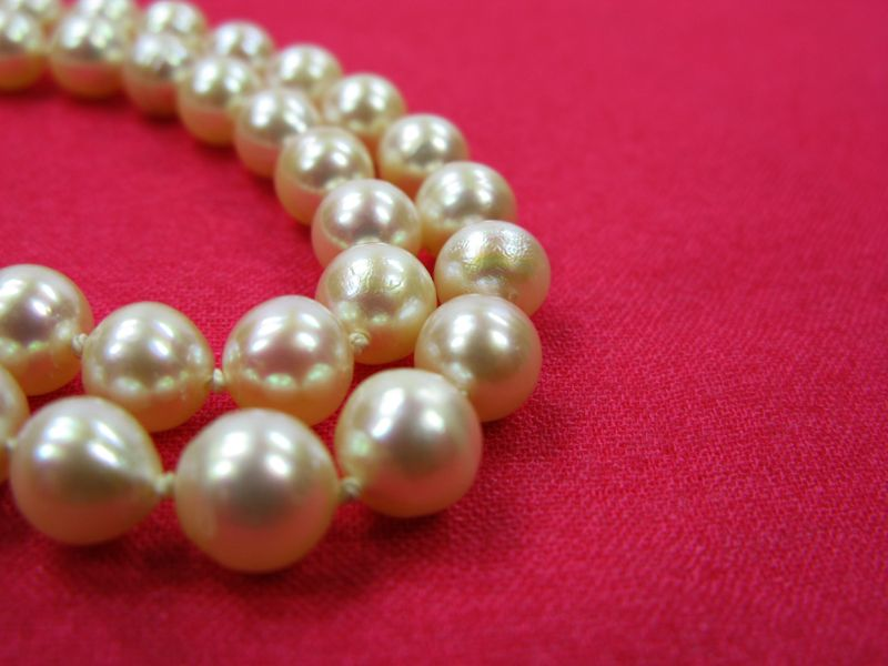 Pearls on red background