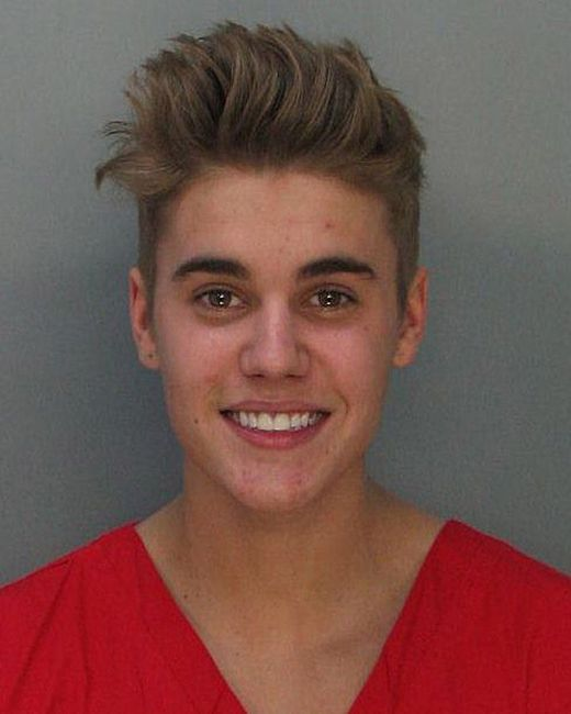 MIAMI, FL - JANUARY 23: In this handout photo provided by Miami-Dade Police Department, pop star Justin Bieber poses for a booking photo at the Miami-Dade Police Department on January 23, 2014 in Miami, Florida. Justin Bieber was charged with drunken driving, resisting arrest and driving without a valid license after Miami Beach Police found the pop star street racing on Thursday morning. (Photo by Miami-Dade Police Department via Getty Images)