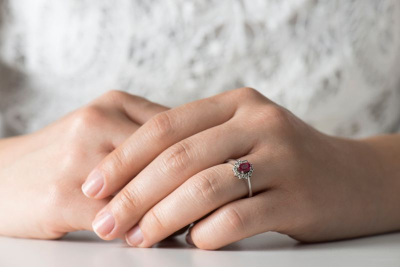 Woman and ruby diamond ring.