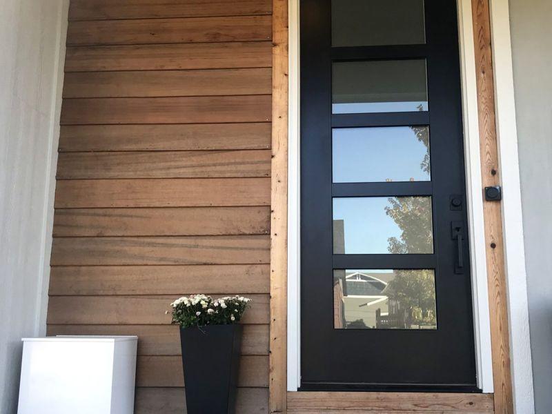 Understated black front door