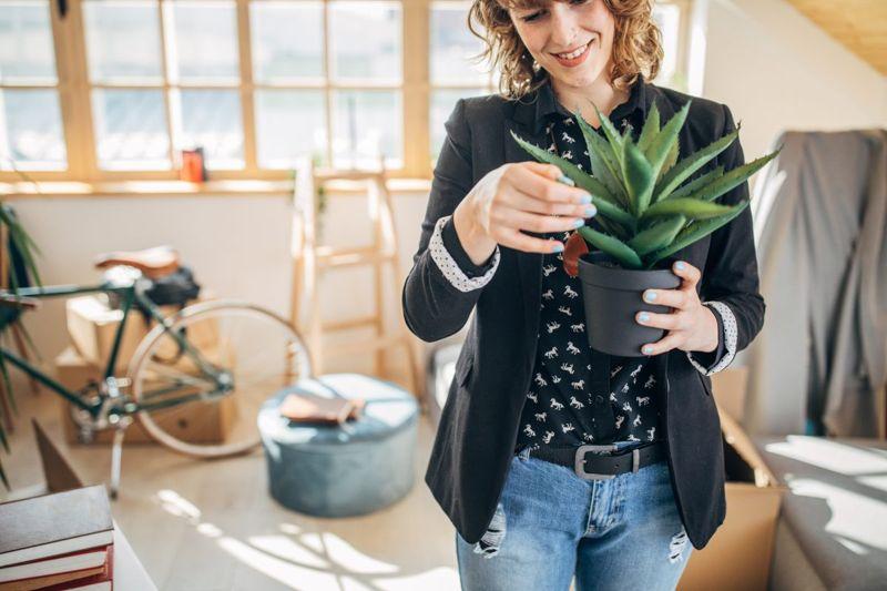 Woman holding a pot plant
