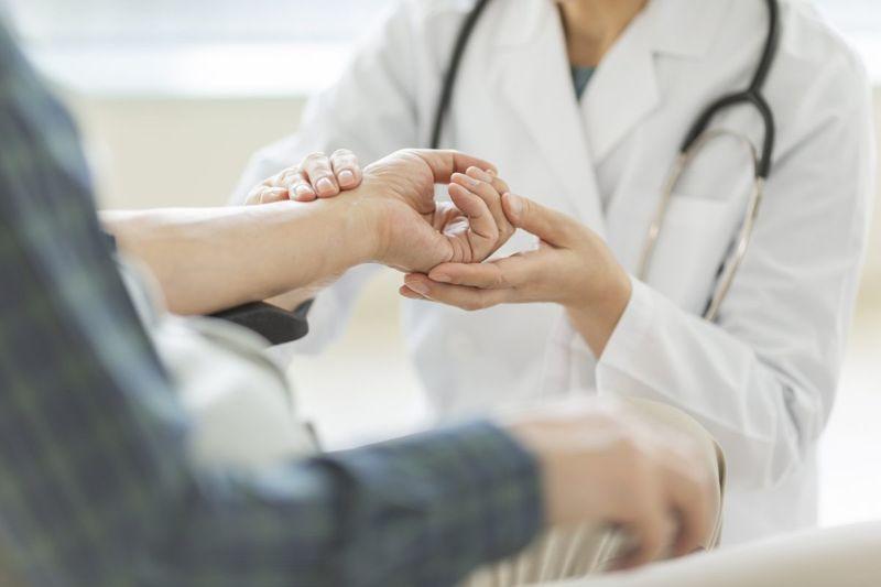 doctor examining hand