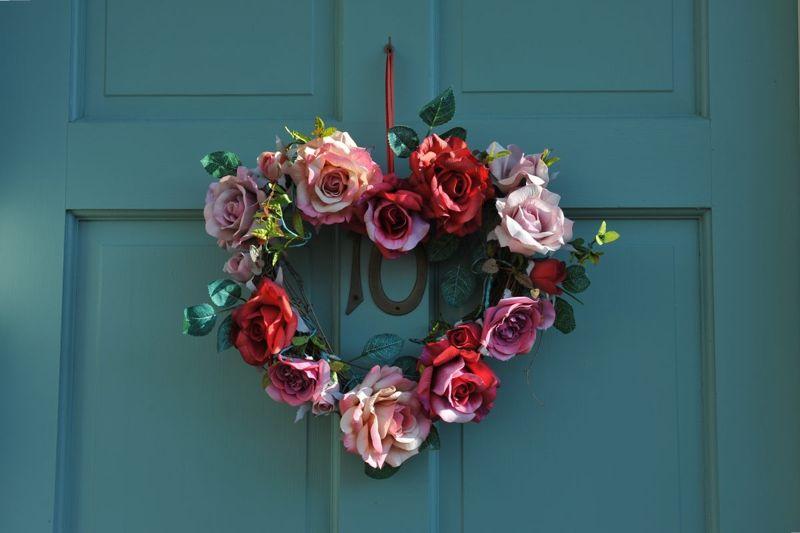 A door wreath welcomes guests