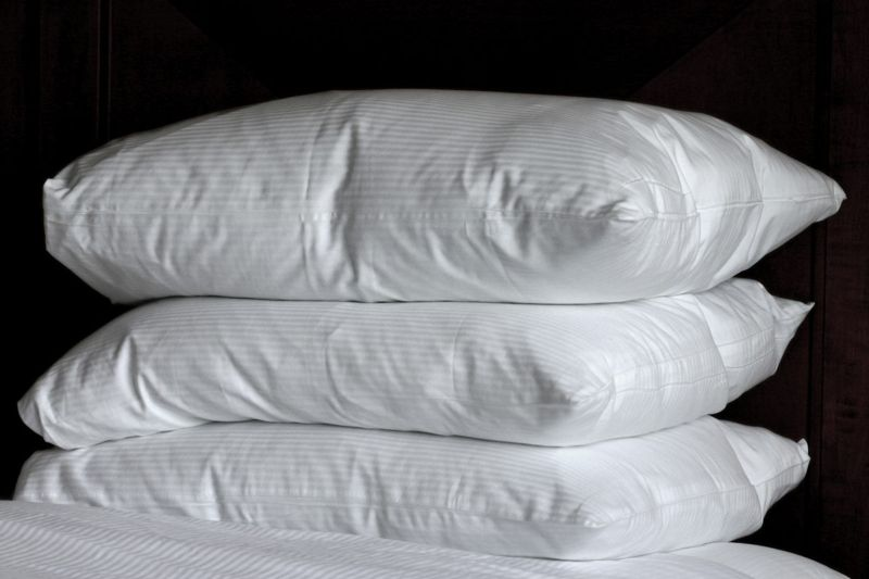 Remove pillowcases and coverings
