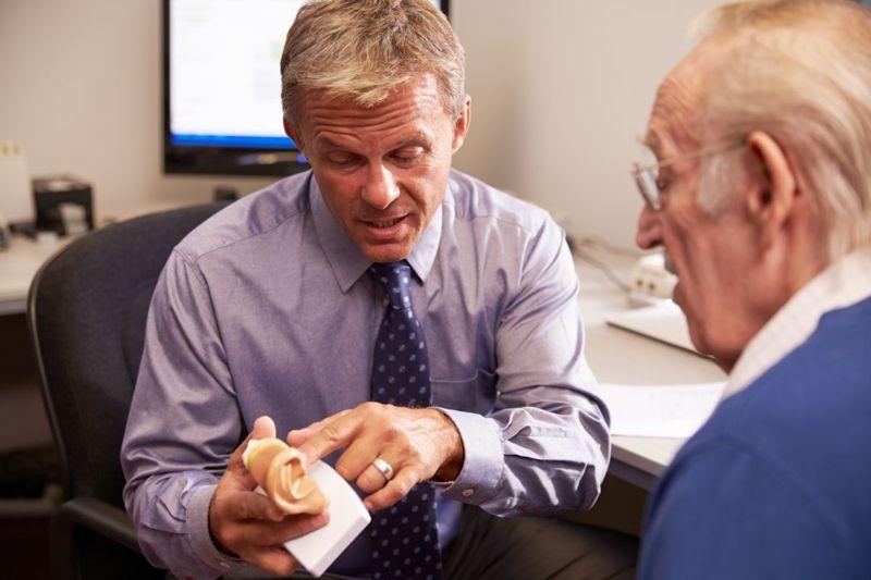 doctor explaining patient ear
