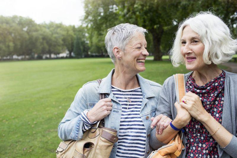 two women walking in park