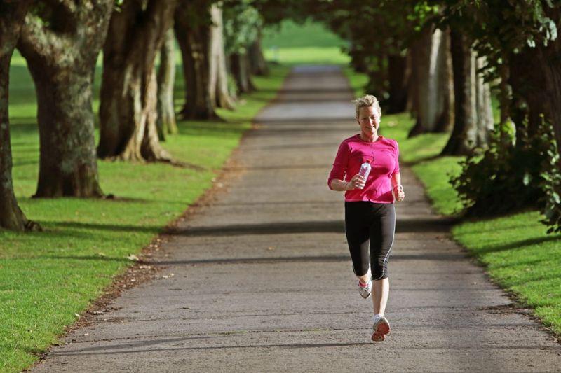 Woman running through landscape